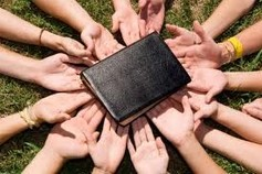 Group of Hands Holding Bible